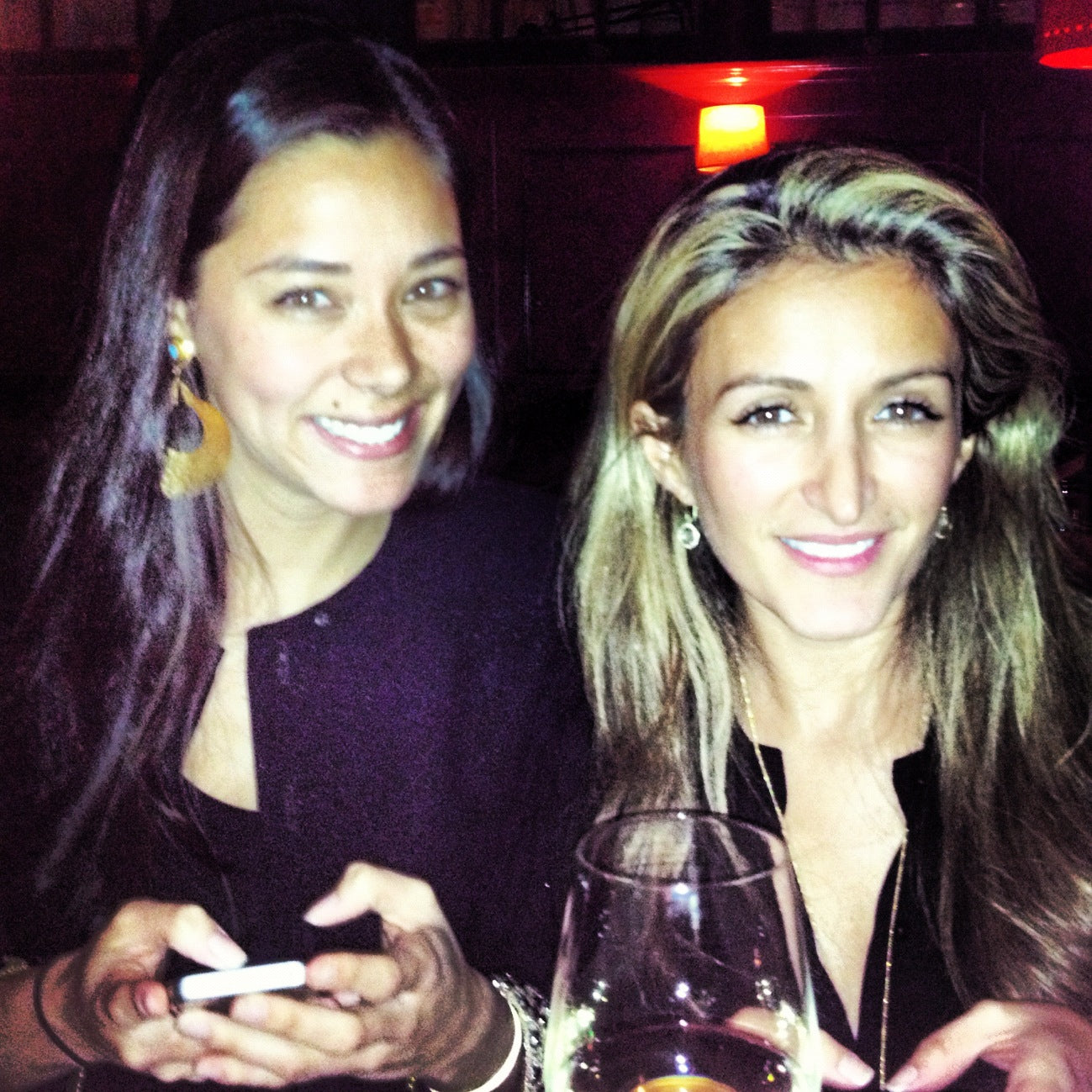 Amanda and Nazy with dueling iPhones.