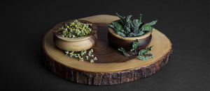 Chamomile and Peppermint tea in wooden bowls by Earthwise Beauty