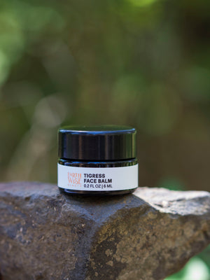 Tigress Face Balm 30 ml 1 oz jar displayed on a piece of raw copper by Earthwise Beauty