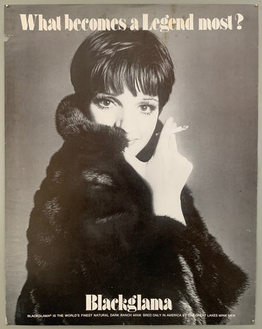 A woman stares coyly at the camera with huge eyes and long eyelashes, colding a cigarette. Her coat covers part of her face. The text is on the top and the bottom in white.