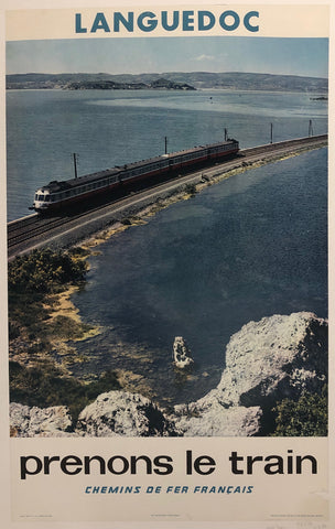 Poster of a black train driving down a railway track across the water.