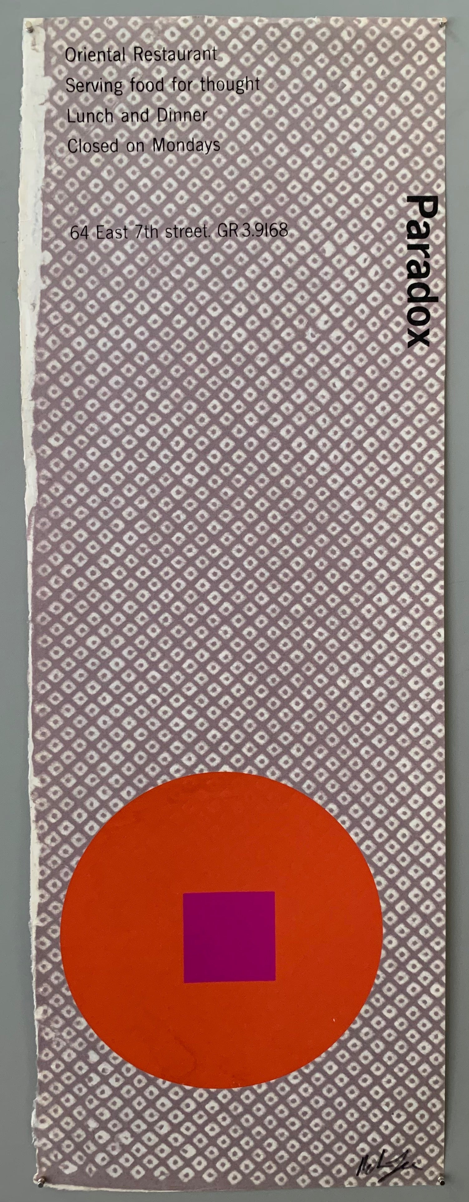 A red circle with an purple square on a white and blue hatch patterned paper.