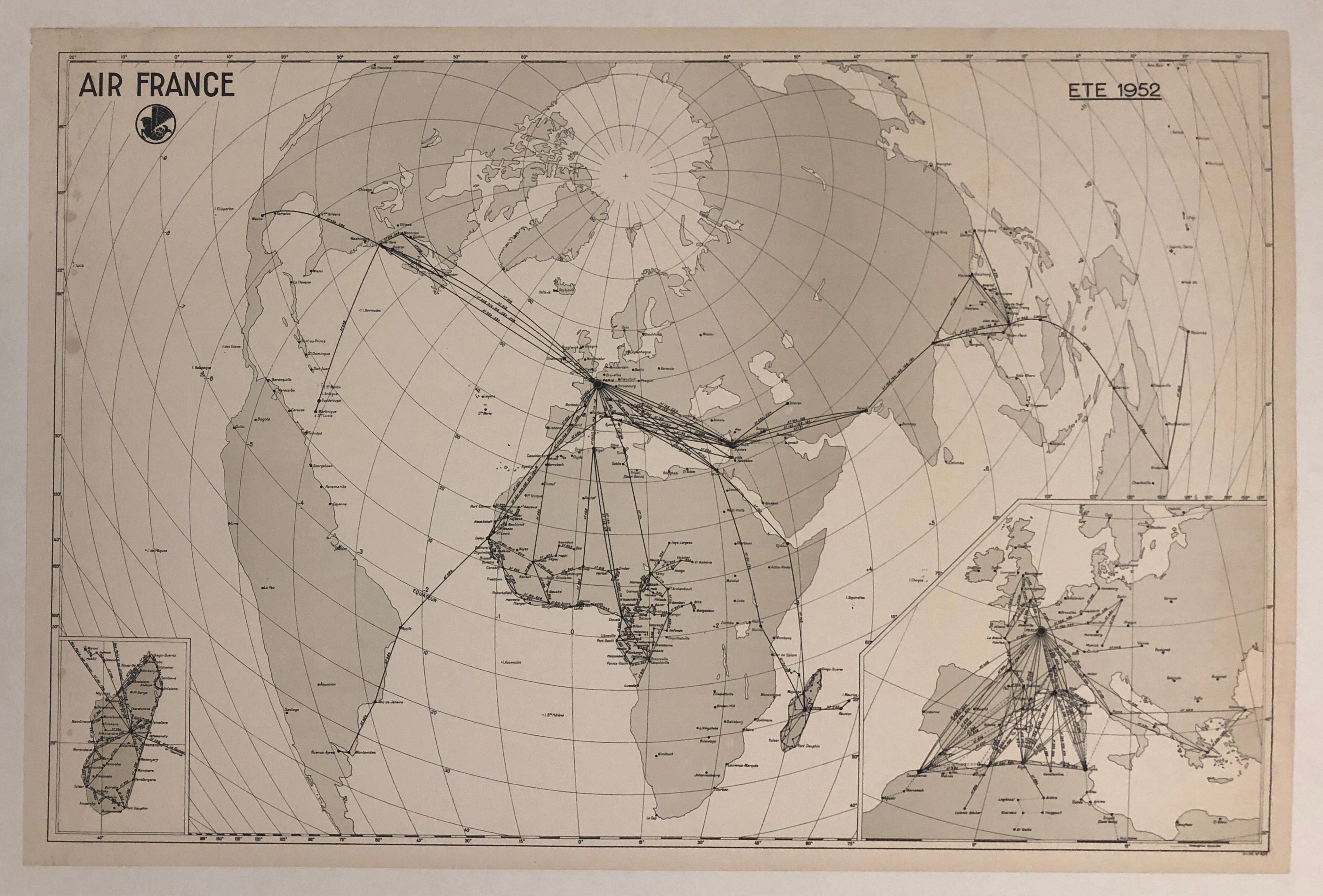 A black and white map of a globe laid flat. Flight lines stretch across it and the linear and latitude lines add more texture.