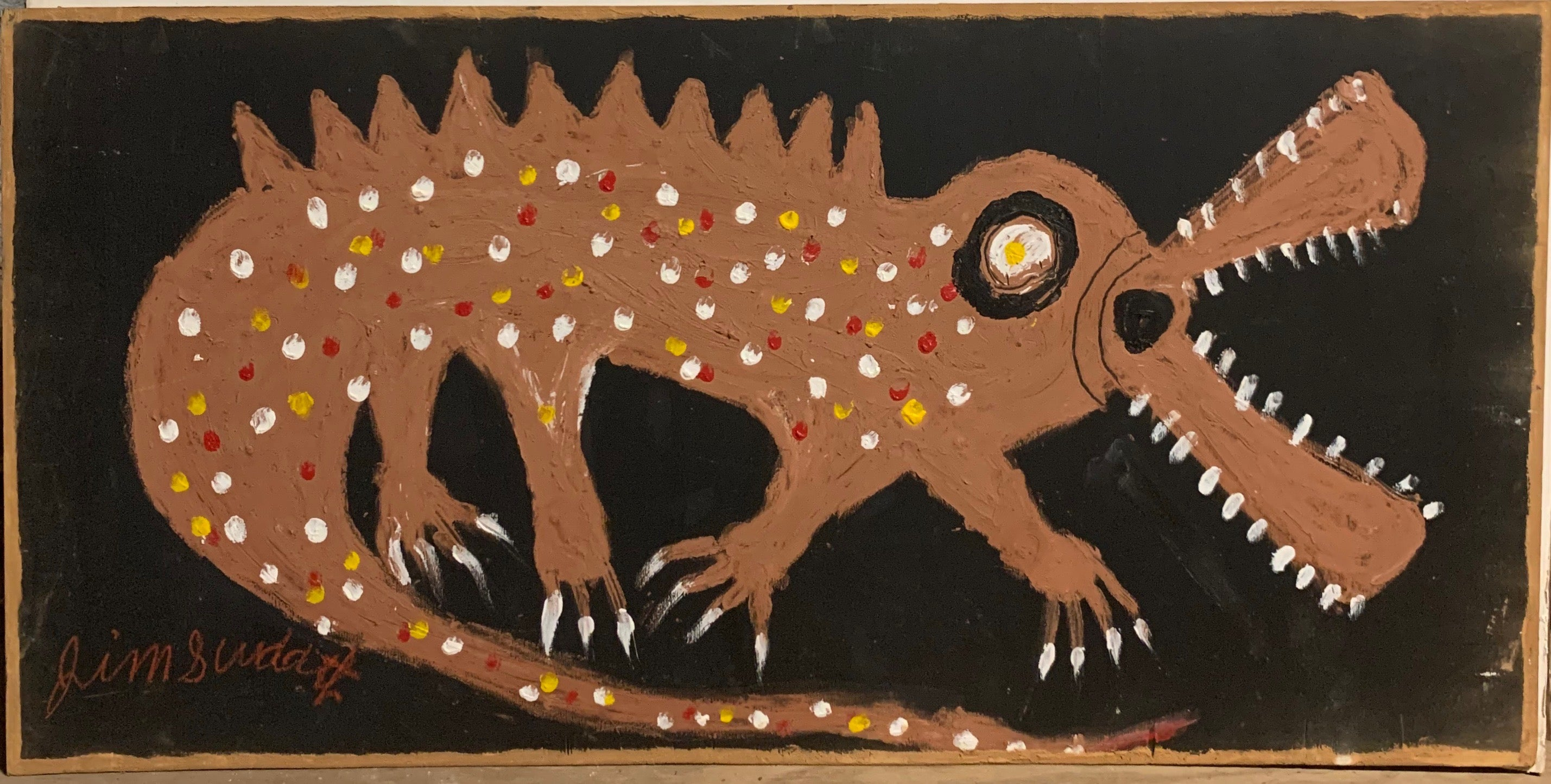 A painting of a polka-dotted alligator.