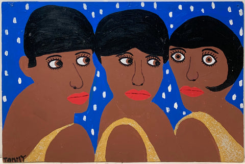 A Tommy Cheng portrait of The Supremes, all three members wearing red lipstick and golden dresses.