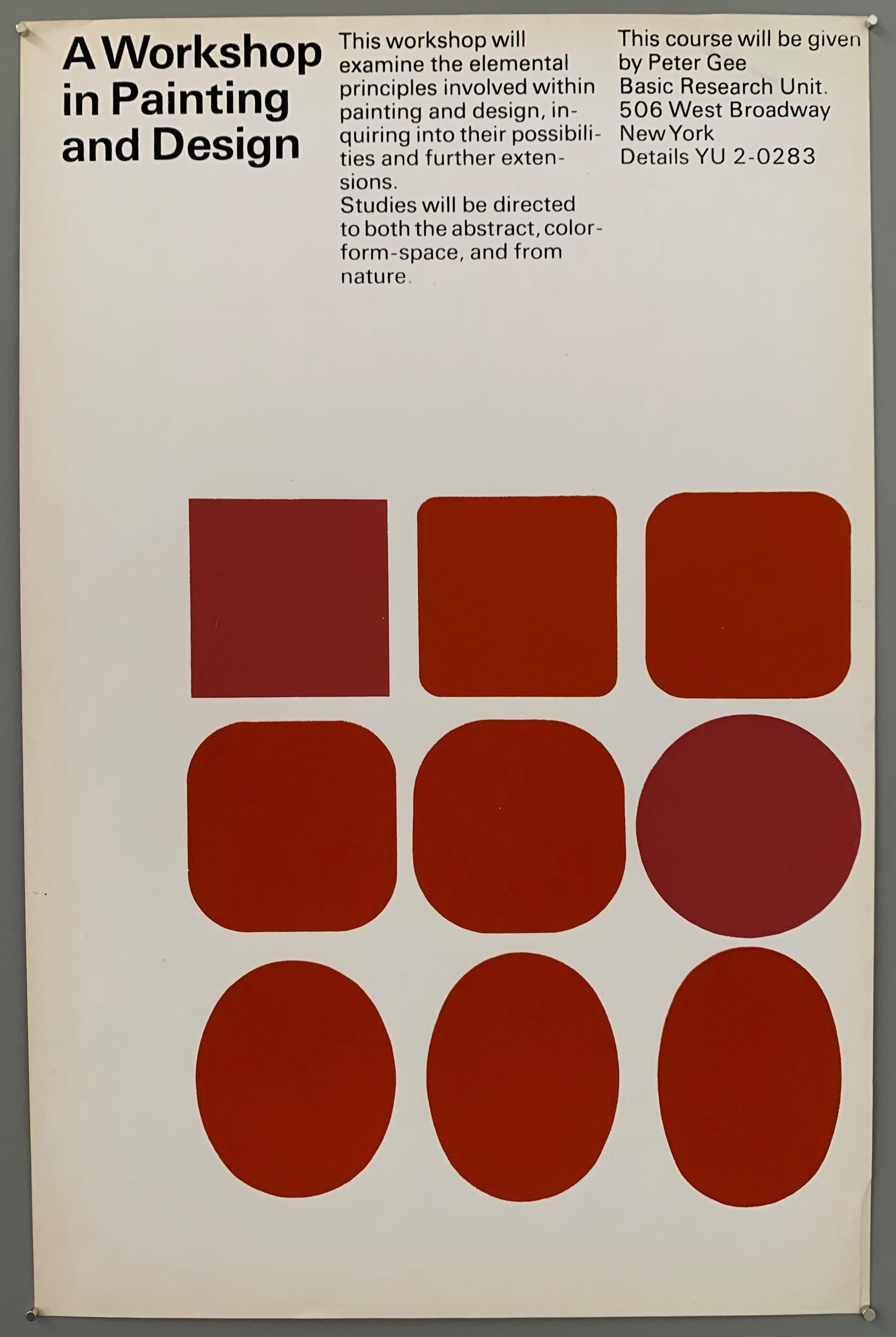 White poster with red squares and ovals