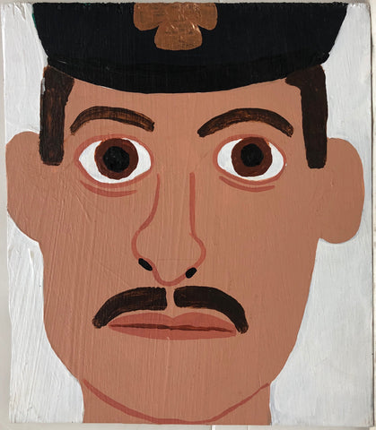 Portrait of Eric Allen, moustached and in a black firefighter's hat.