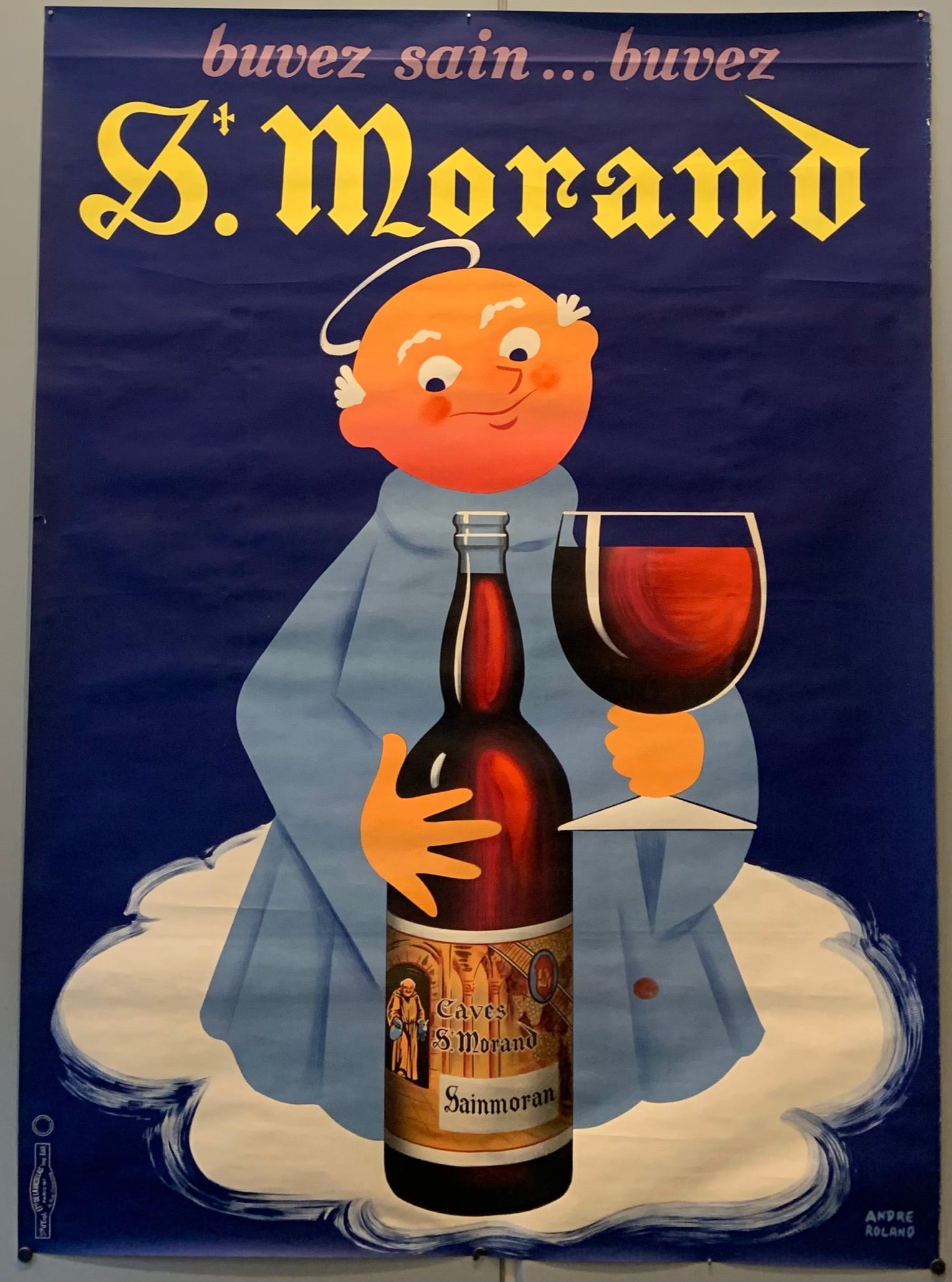 A poster of a saint with a halo drinking red wine.