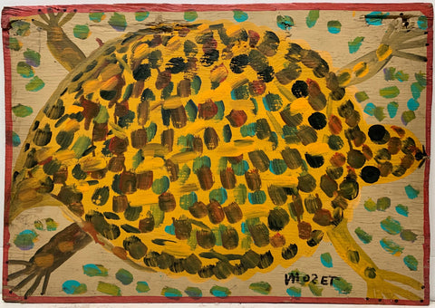A Mose Tolliver painting of a yellow tortoise with a shell speckled with red, green, blue, and black dots.
