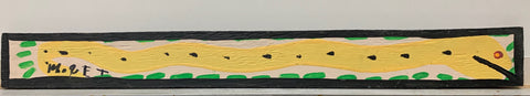 A Mose Tolliver painting of a yellow snake speckled with black and with a red eye.