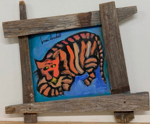A Brian Dowdall painting of an orange-striped tiger lying in wait.