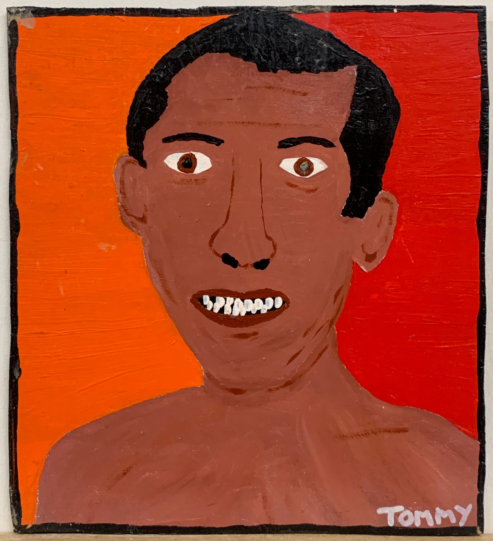 Portrait of a toples Duke Kahanamoku on a red background.