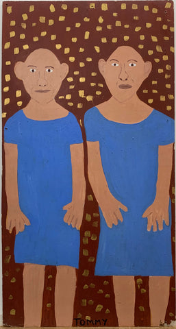 Portrait of twins Pip and Flip, both bald and wearing matching blue dresses.