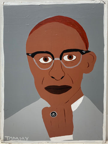 A Tommy Cheng portrait of Malcolm X with red hair on a gray background.