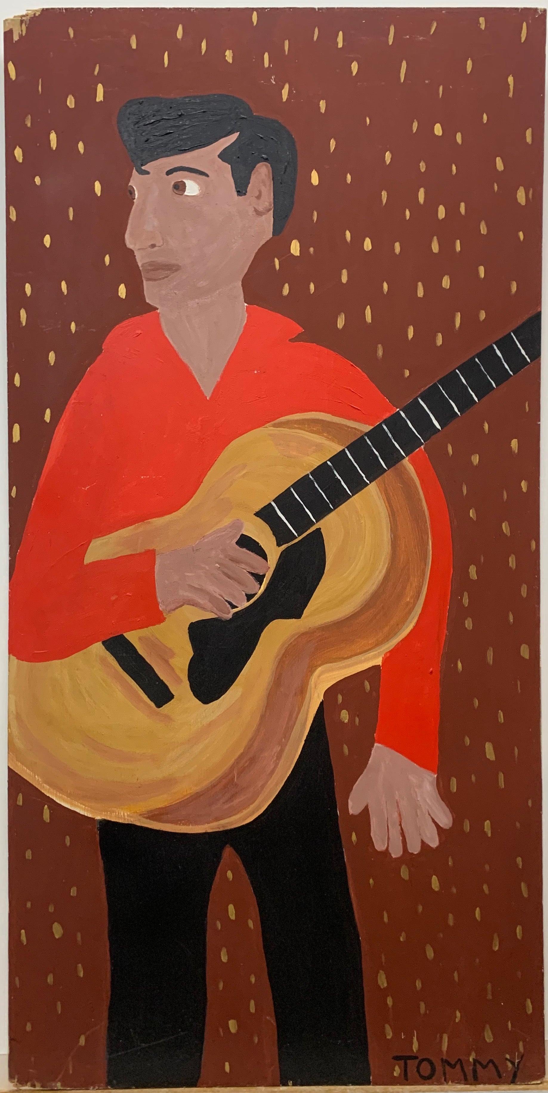 A Tommy Cheng portrait of Elvis Presley with a guitar and wearing a red shirt and black slacks.