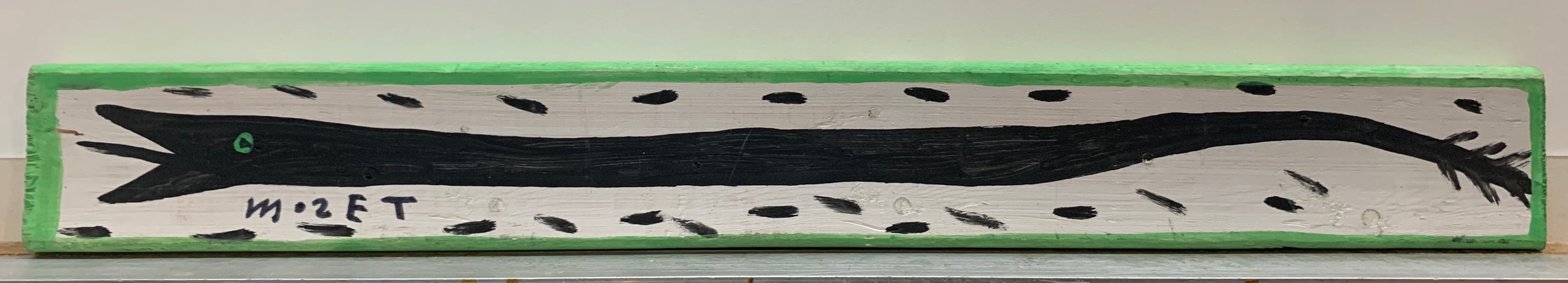A Mose Tolliver painting of a black snake with a mint green eye.
