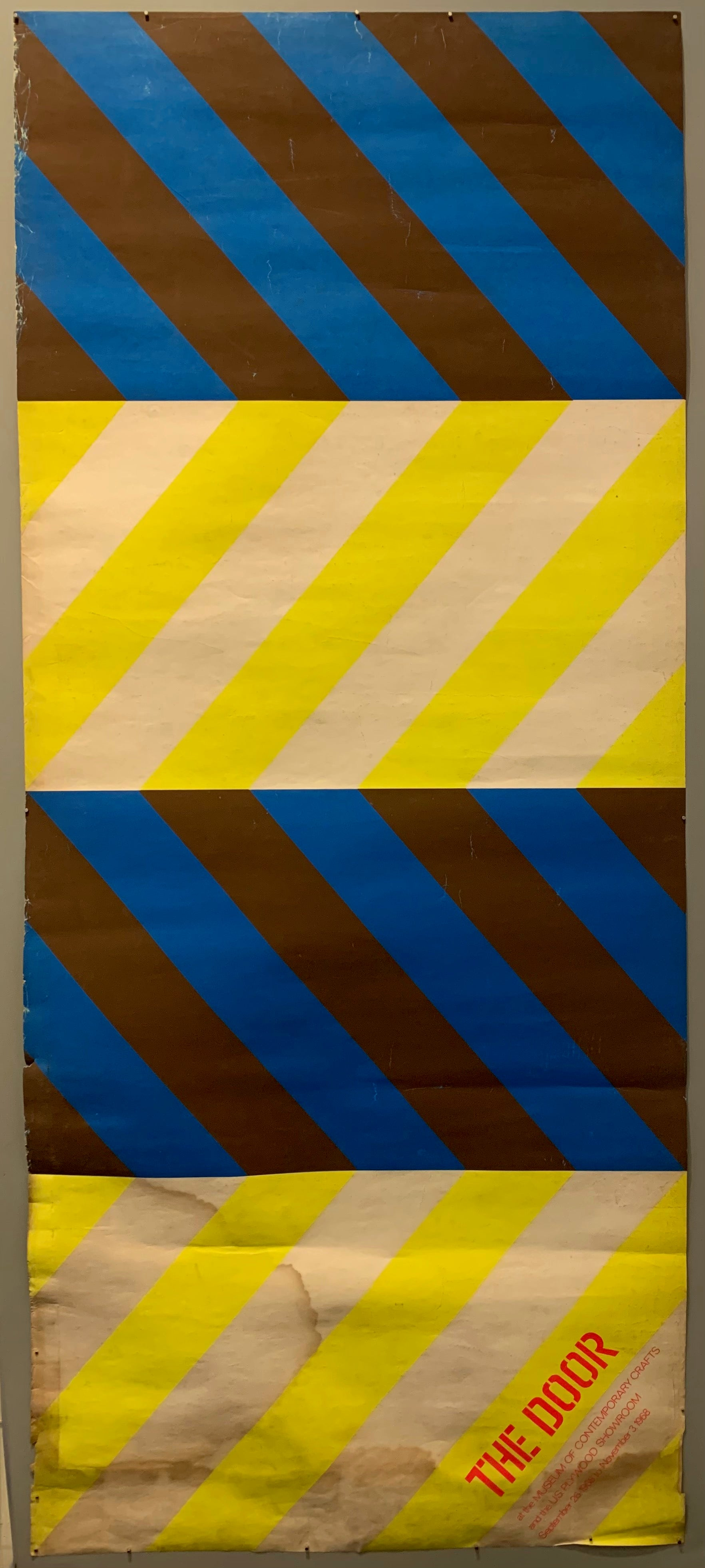 This mix of multicolored diagonals is eye-catching and bold and creates a chevron print. The main colors are yellow and white and black and blue.