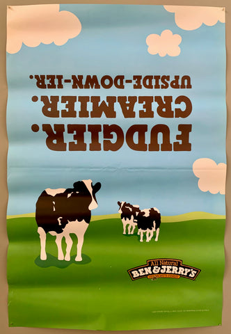 poster of the Ben&Jerry cows on a green field under a blue sky with clouds