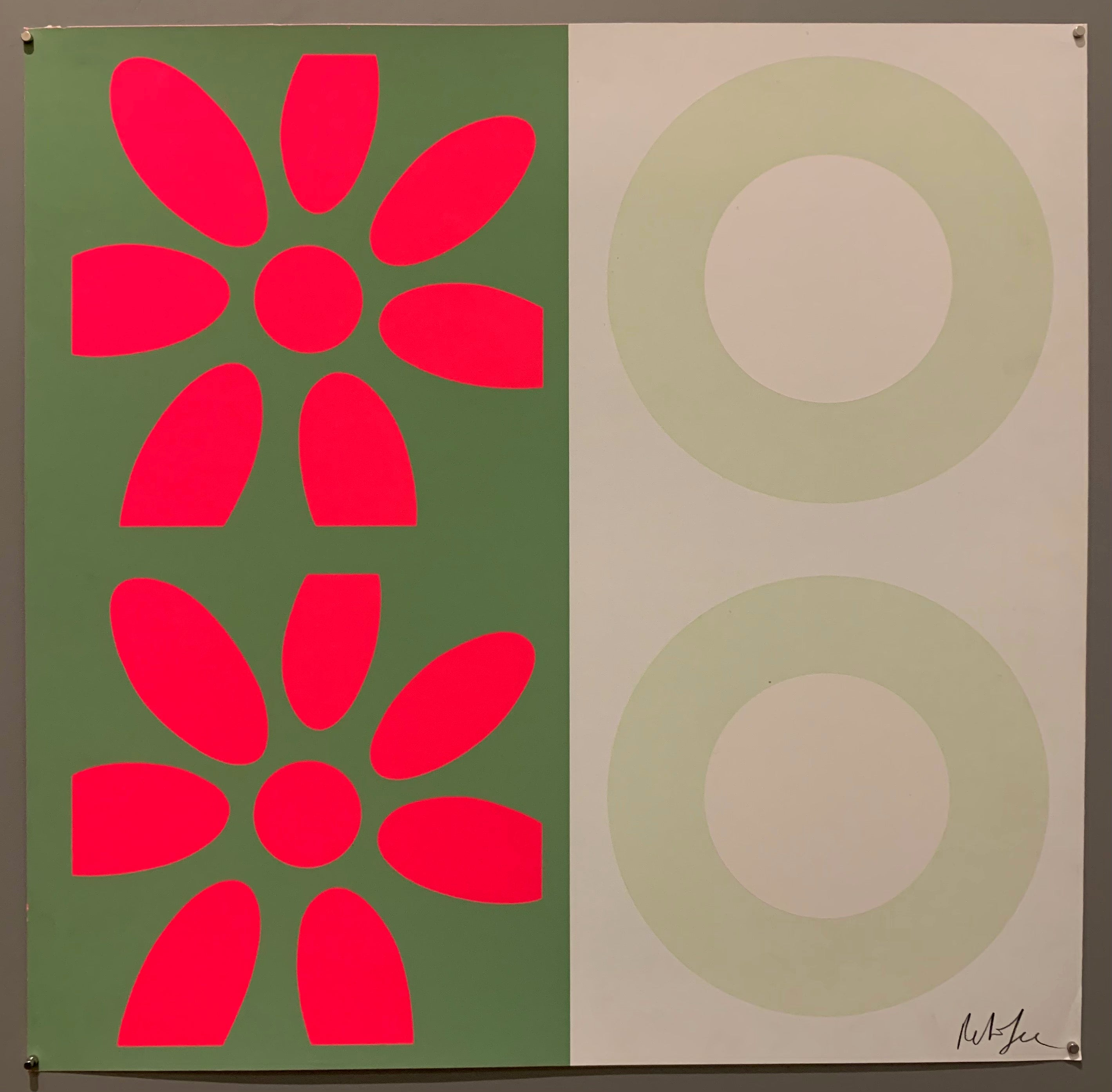 A square of four large motifs on paper. The colors are mossy green with hot pink flowers, the other is white with cream targets.