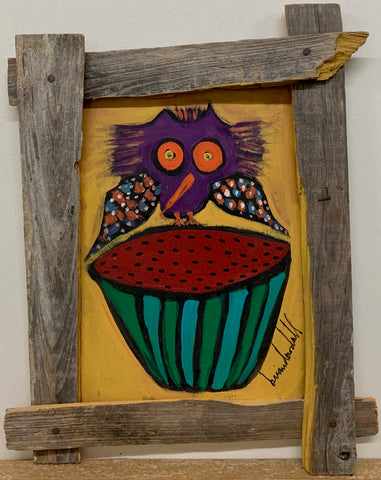 A Brian Dowdall painting of a purple owl perched on a red watermelon.