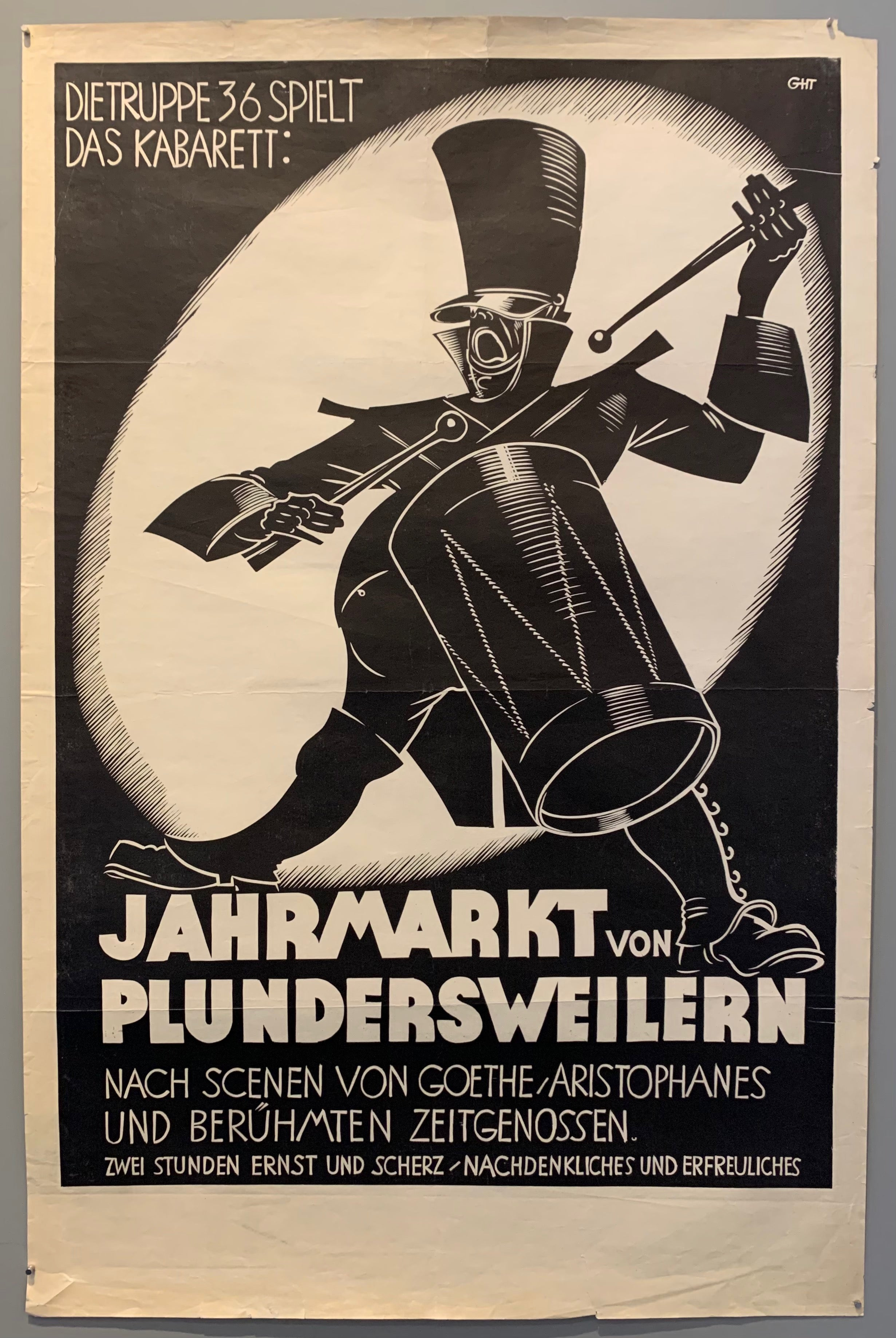 Dramatic black and white poster of a man playing a drum.