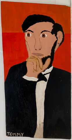 A Tommy Cheng portrait of Abraham Lincoln in a black suit against a red background.