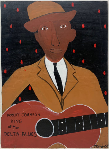 A Tommy Cheng portrait of Robert Johnson holding a red guitar and wearing a tan suit and hat.