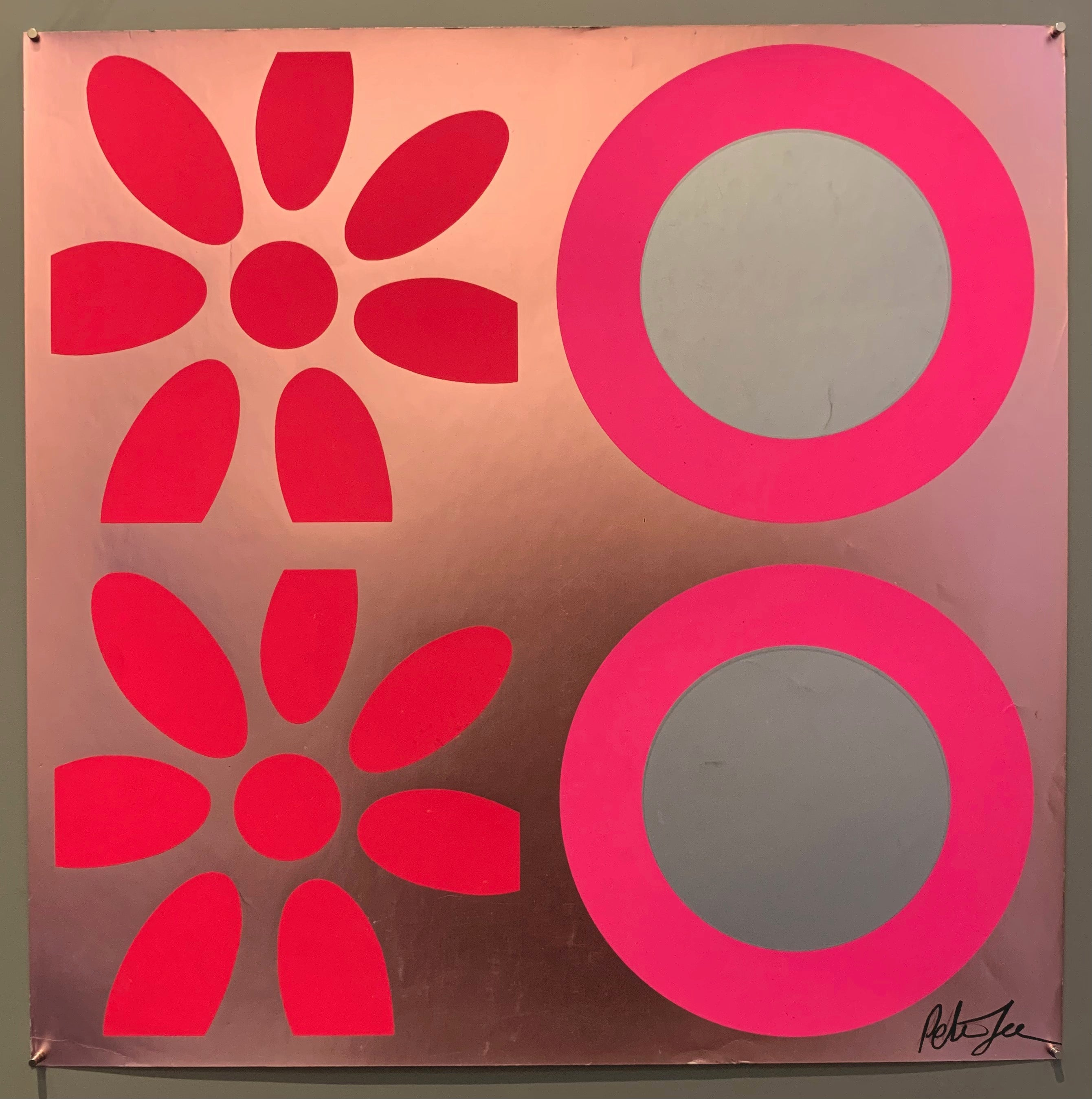 A square of four large motifs on paper. The colors are pink, grey, and metallic pink.