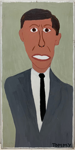 A Tommy Cheng portrait of JFK with his teeth clenched, wearing a gray suit.
