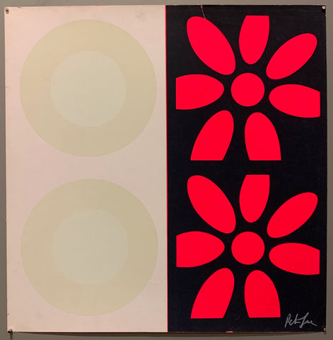 A square of four large motifs on paper. The colors are white with cream targets, the other is black with hot pink targets.
