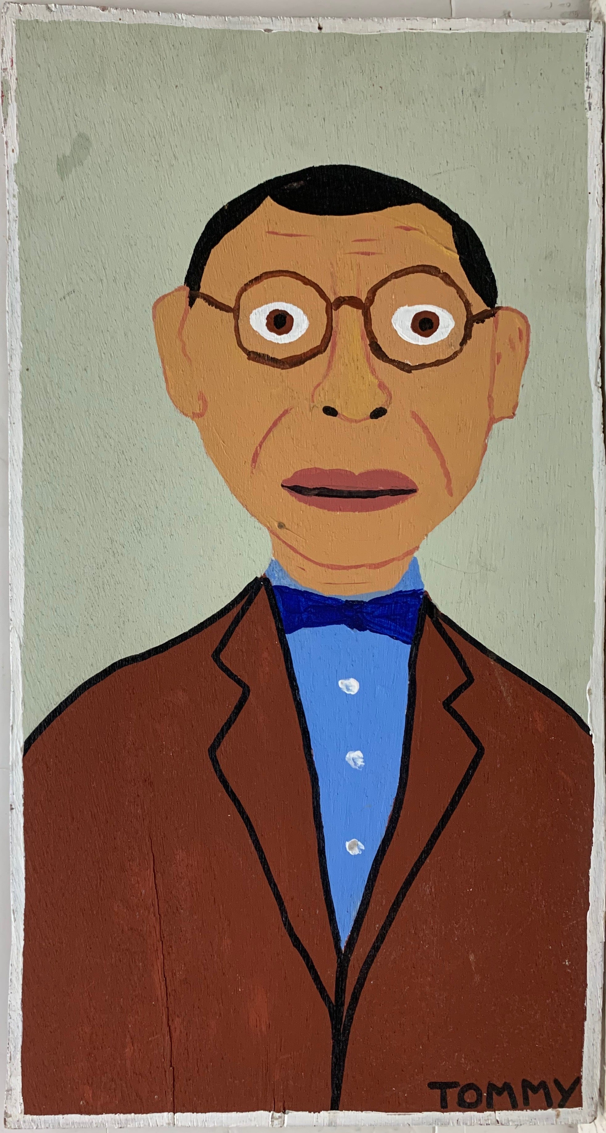 A Tommy Cheng portrait of a man with round glasses, a brown suit jacket, and a blue bow tie.