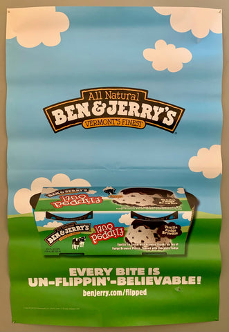 poster of a container of Ben & Jerry's ice cream on a green hill under a blue sky with clouds