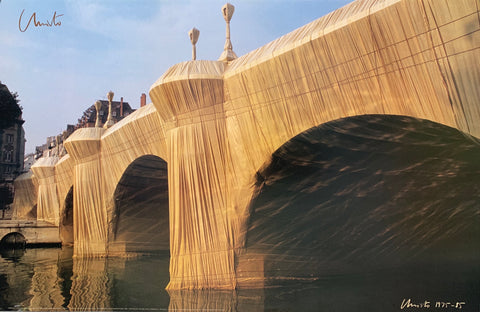 A close-up photo of the wrapped bridge from the river.