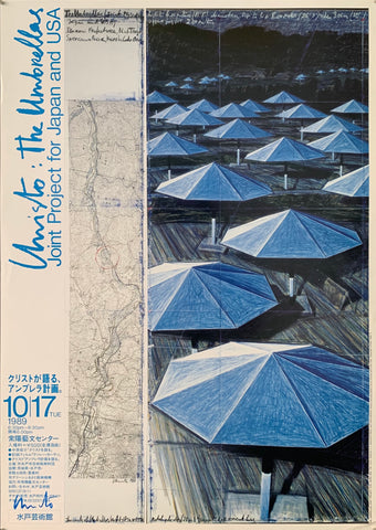 A sketch of blue umbrellas next to a topographic map. Japanese writing in blue is on the side.