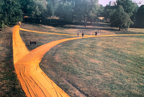 Colored photograph with yellow forking path with children running on it.
