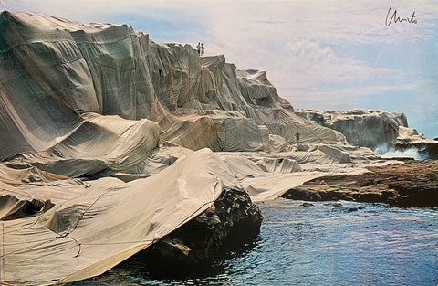 Colored photograph of rocks covered in white fabric.