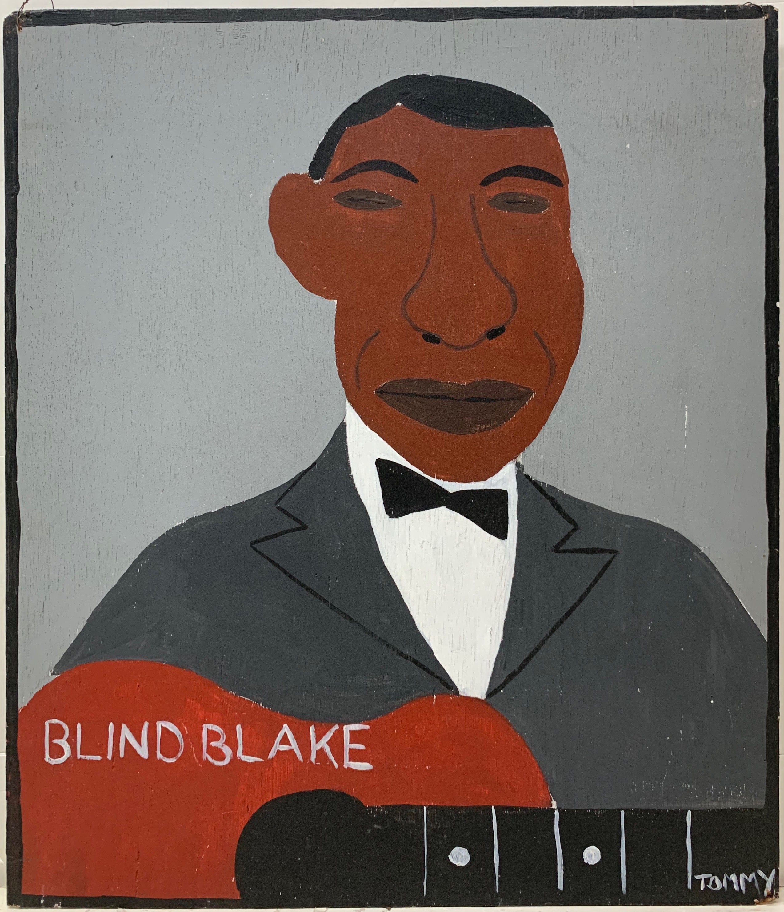 Tommy Cheng portrait of Blink Blake with a guitar and in a gray suit.