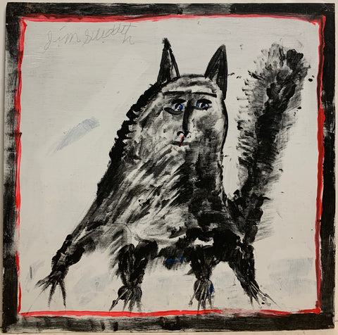 A Jimmie Lee Sudduth painting of black dog.