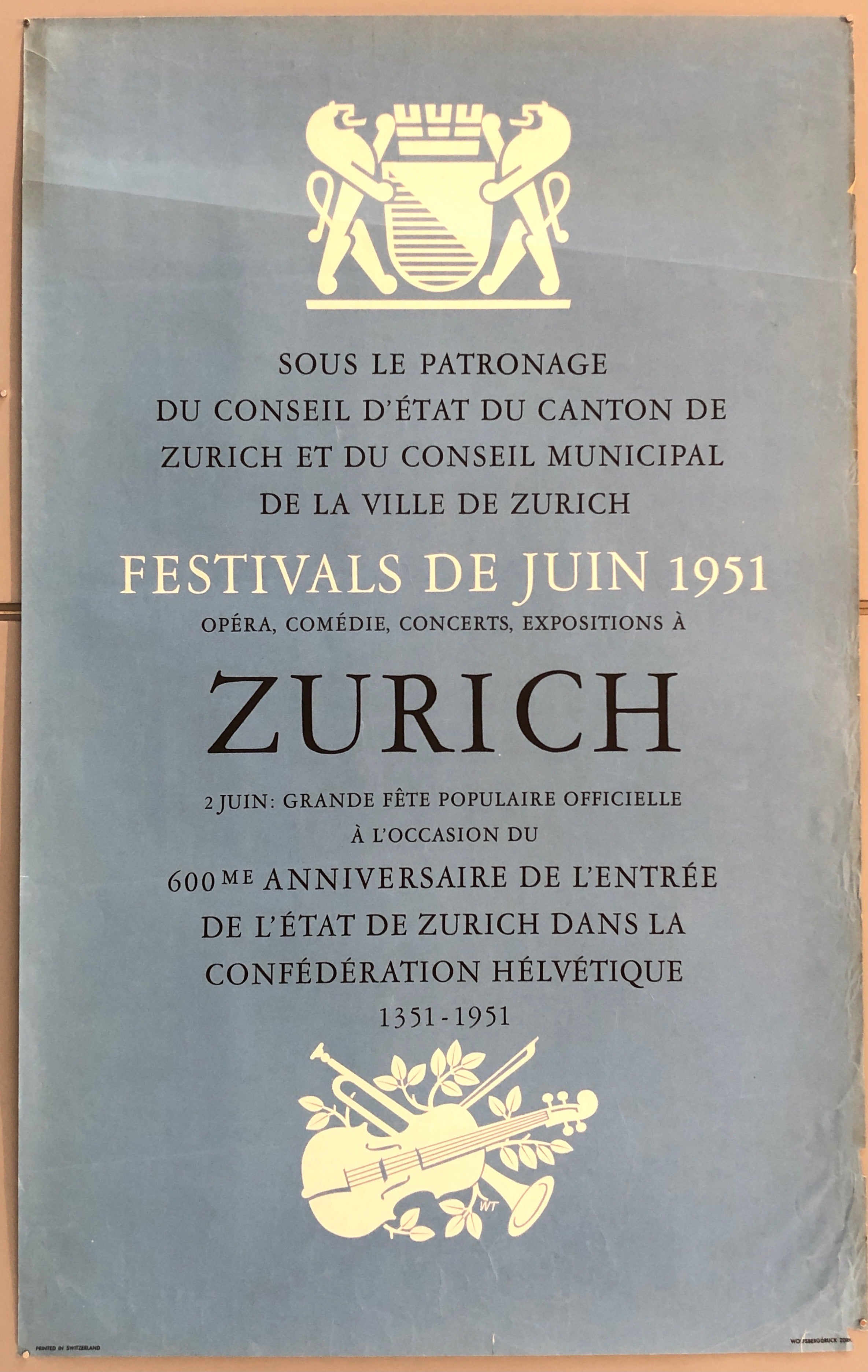Baby blue poster with text describing a June Festival