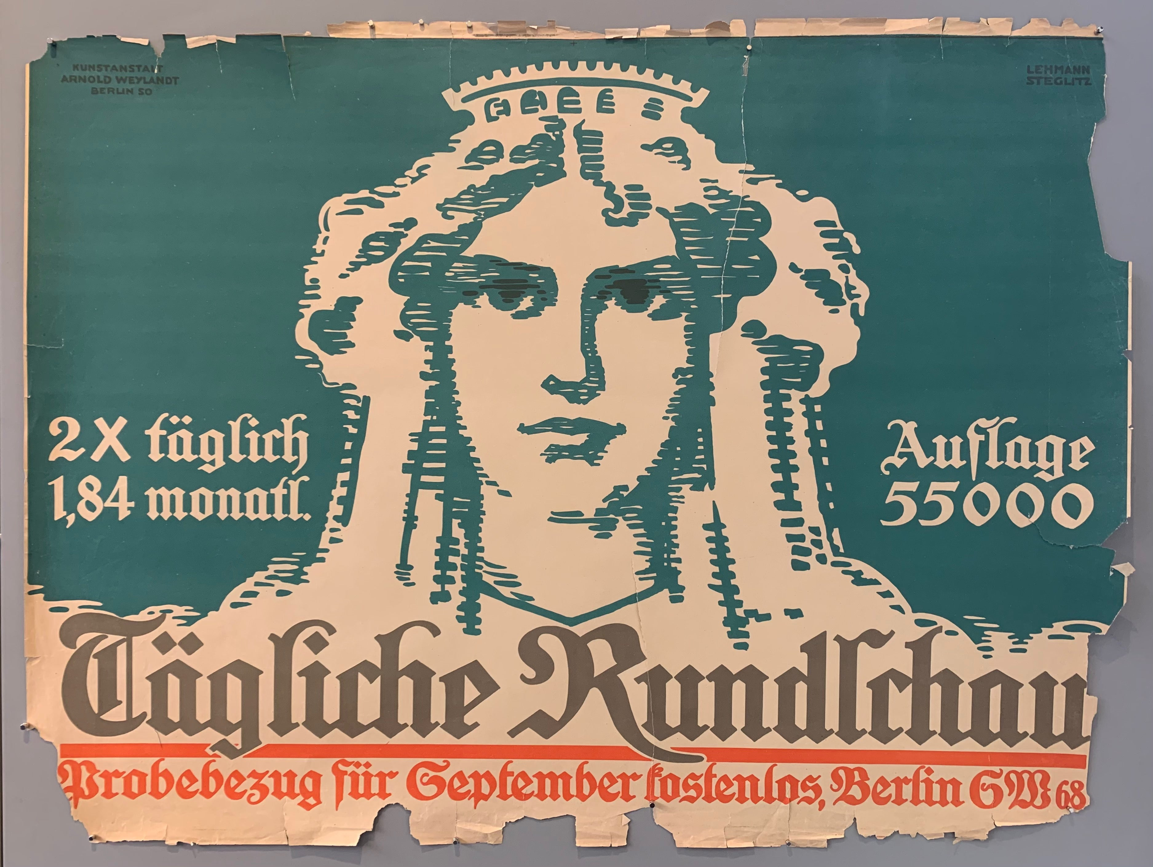 The daily Rundschau was a newspaper published from 1945 to 1955. It was published in Berlin by the Soviet army in the Soviet occupation zone. This poster advertises sample purchases in september for free, with a woman in the middle. Background is turquoise with red and white text.