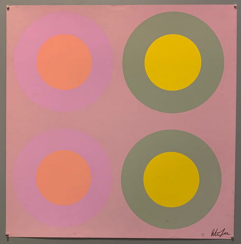 A square of four large motifs on paper. The colors are mauve with light purple and pink targets, the other is mauve with seafoam green and yellow targets.