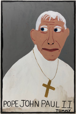 Portrait of Pope John Paul II in a traditional white robe with a golden cross around his neck.