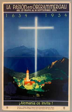 A glowing cross hovers above a small town illuminating the town but keeping the outer forests and mountains dark.