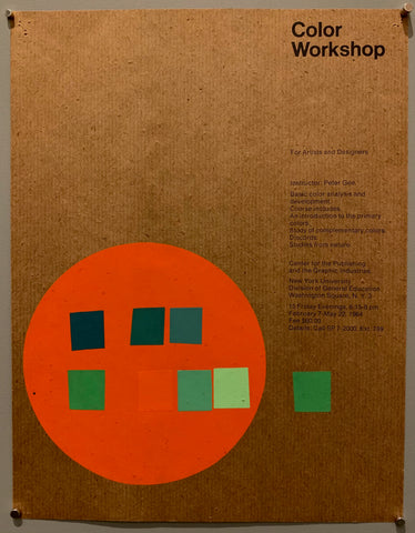 A brochure cover has simple arial font in black. The paper itself is a brown ribbed cardboard-like paper. The bottom left has a big orange/red circle with 7 boxes of different shades of green and blue, along with one orange one. A green box is on the outside.