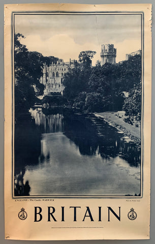 This poster is sepia toned with bold black-and-white writing at the bottom. The photograph takes up the majority of the page.The photograph contains a view of a serene riverbank. The river is framed by trees and in the background a cathedral is shown.