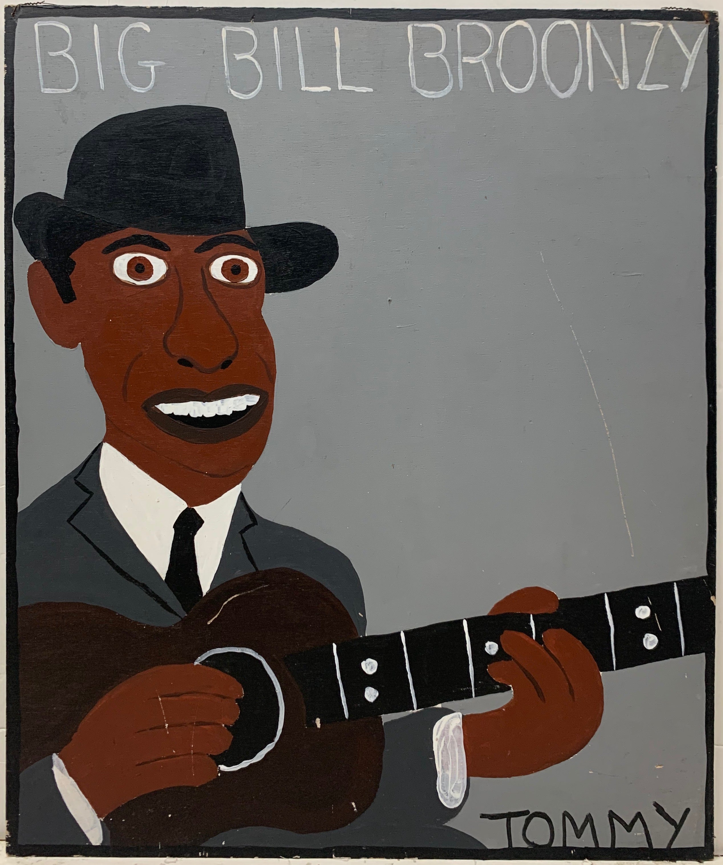 A Tommy Cheng portrait of Big Bill Broonzy with a black guitar, black hat, and gray suit.