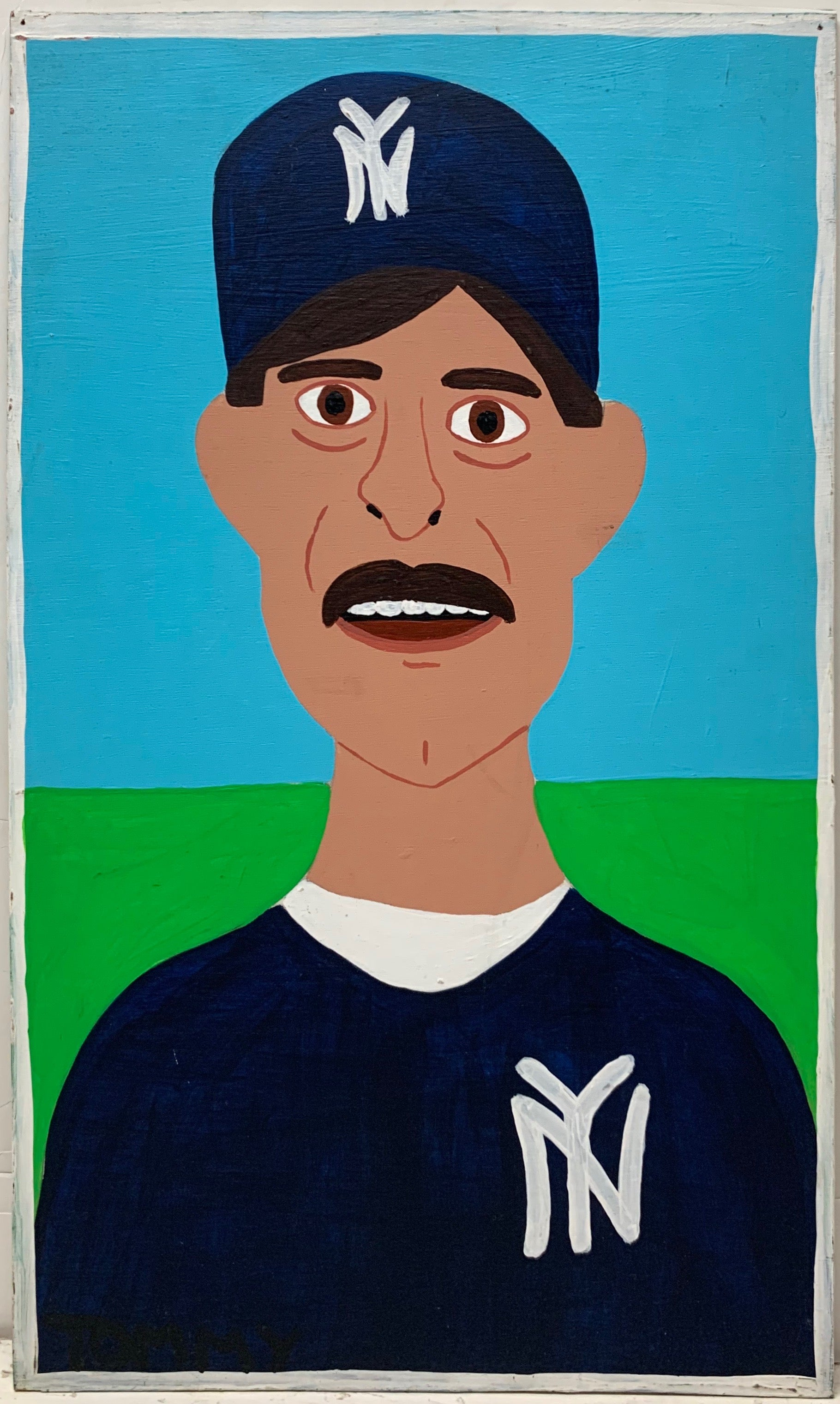 A Tommy Cheng portrait of Don Mattingly in a New York Yankees uniform, standing against a green field and blue sky.