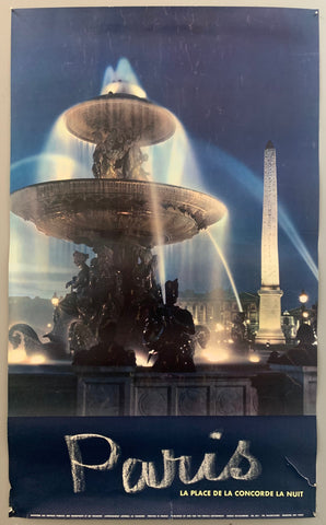 A blue photograph shows a light-up fountain with sculpture. Behind is is a lit up obelisk. The text is at the bottom with paris written in cursive and the other writing in an all-caps font.