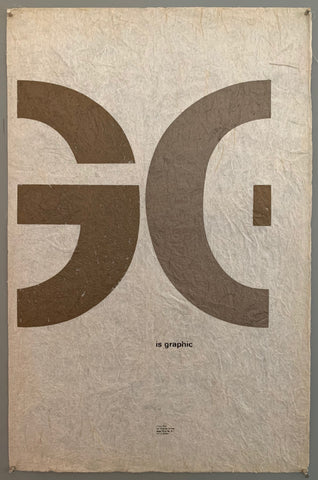 "A mostly plain paper has G and part of an E written across the middle in huge font. ""is graphic"" is written below in smaller font, and the tudio address is written much smaller towards the bottom. The colors used in this are brown, grey, and a textured white paper."
