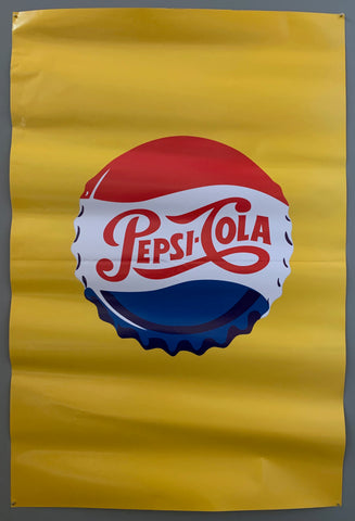 pepsi bottle cap on a yellow background